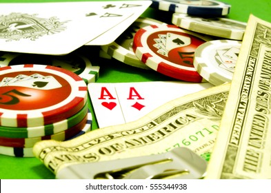 Poker table with chips, money and playing cards