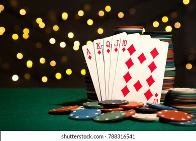 Poker table during a game. Winning combination royal flush. Chips and cards on the table.