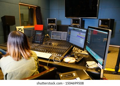 Pokfulam, Hong Kong - 3 March 2019: Student working at a recording studio at campus of The Hong Kong Academy for Performing Arts