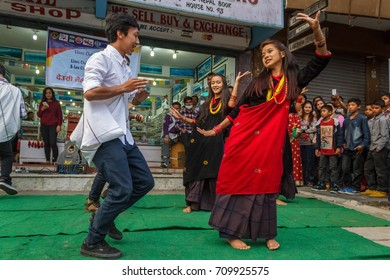 POKHARA, NEPAL - 11/9/2015: A group of young Nepalese dancers perform in traditional clothes during the Tihar festival in Pokhara, Nepal.