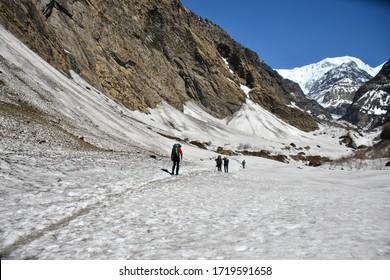 POKHARA, NEPAL - APRIL 11,2019: Trekker walking on the way to Annapurna base camp with snow path viewing, Pokhara