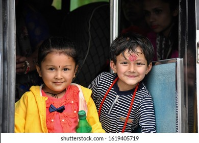 POKHARA, NEPAL - APRIL 5,2019: Portrait of Nepali girl with color dot worn on centre of forehead called Hindi, Pokhara