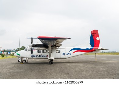 POKHARA, NEPAL - CIRCA OCTOBER 2017: A Nepal Airlines Harbin Y-12E airplane at Pokhara Airport. The rear left tyre seems to be punctured.
