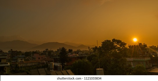 Pokhara, Nepal - Circa September 2017 - A beautiful panoramic shot of Pokhara cityscape and mountains range in the background during sunrise
