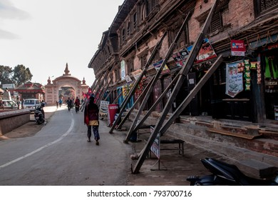 POKHARA, NEPAL - DECEMBER 16,2017:  The street to Pokhara dubar square where buildings are using the long wood to lean the building for making it not collapse from the earthquake.