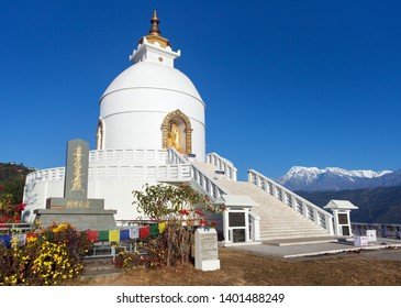 Pokhara, Nepal - December 9 2017 - World peace stupa near Pokhara, one from the best stupas in the world with people and Annapurna range