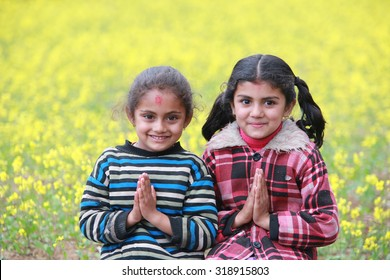 POKHARA, NEPAL, Feb 18 : welcome gesture of hands by two young Nepali girls  at Pokhara on Feb 18, 2015