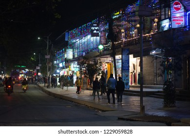 Pokhara, Nepal - November 7, 2018 : People on the streets in the night, documentary editorial.