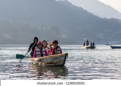 Pokhara, Nepal - November 8, 2018 : Tourist in the boats to Barahi Temple on Phewa lake, documentary editorial.
