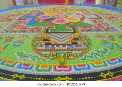 POKHARA, NEPAL - OCTOBER 06 2017: Close up of a detailed and colorful typical handmade carved structure in the ground of the building, inside of The Pema Ts al Sakya Monastic Institute, in Kathmandu