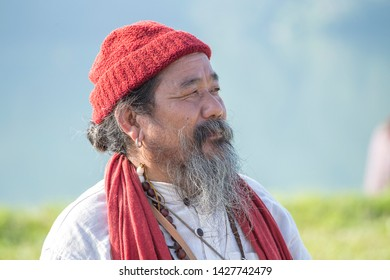 POKHARA, NEPAL - OCTOBER 07, 2016 : Portrait Tibetan Lama conducts classes with sunsurfer people on meditation and yoga near the lake