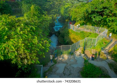 POKHARA, NEPAL OCTOBER 10, 2017: Unidentified people taking pictures and enjoying the devi's falls with a metallic protection for the tourists in Pokhara, Nepal