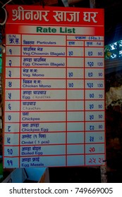 POKHARA, NEPAL OCTOBER 10, 2017: Informative sign of prices of the food inside of the food market in Pokhara, Nepal