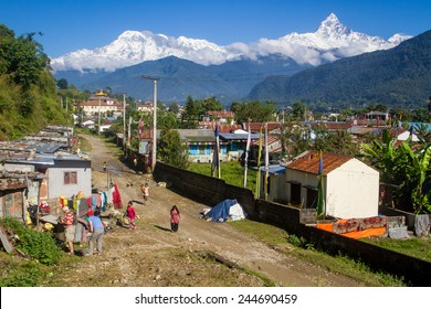 POKHARA, NEPAL- October 15, 2014- A refugee camp near the city of Pokhara, Nepal, for Tibetans and other refugees. The peak of Machhapuchhre is in the background.