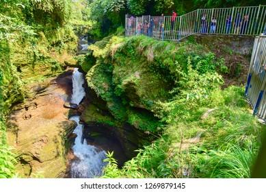 Pokhara, Nepal - October 21, 2018: Devi's Falls or Davis Falls, a Beautiful Natural Wonder in Pokhara