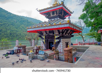 POKHARA, NEPAL - SEPTEMBER 04, 2017: Unidentified people walking around of Tal Barahi Temple, located at the center of Phewa Lake, is the most important religious monument of Pokhara