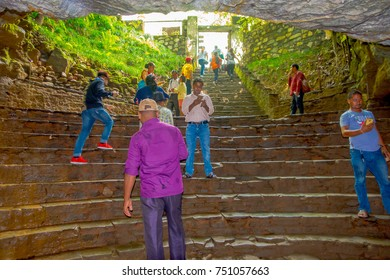 Pokhara, Nepal - September 12, 2017: Unidentified group of people at the enter of Bat Cave walking downstairs and upstairs, in Nepali language, it is called Chameri Gufa. The cave is made of limestone