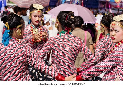 POKHARA, NEPAL - SEPTEMBER 15 - Unidentified Nepali girls prepare for a traditional dancing competition during Nepali festival called Dashain on September 15, 2013.