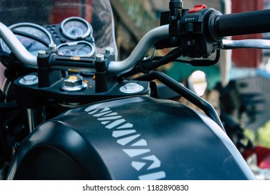 Pokhara Nepal September 18, 2018 Closeup of a Royal Enfield motorcycle parked in the street of Pokhara in the afternoon