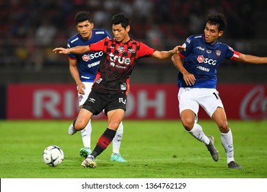 Pokklaw Anan no.10 (red) of Bangkok United in action during The Football Thai League between Bangkok United and SCG Muangthong United at True Stadium on March 02,2019 in Pathum Thani, Thailand