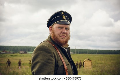 POKROVSKOE, SVERDLOVSK OBLAST, RUSSIA - JULY 17, 2016: Historiacal reenactment of Russian Civil war in the Urals in 1919. Soldier-anarchist