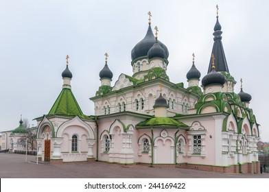 Pokrovsky Monastery, Orthodox Cathedral with a green roof and black domes. Ukraine, Kiev, Kyiv.