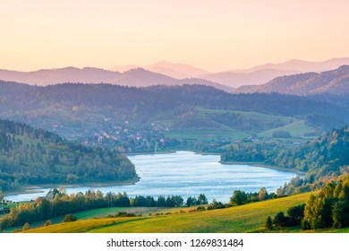 Polanczyk, Bieszczady Mountains. Poland: Sun rising over mountains. Views from near hill. In background Solina Lake.
