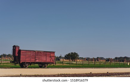 Oświęcim /Poland - 10 August 2019: Auschwitz-Birkenau Memorial and Museum train wagon on the background of furnaces.