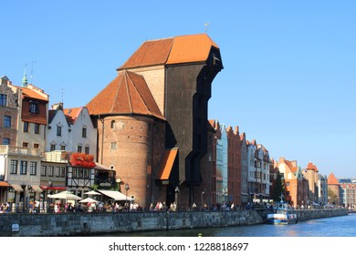Gdańsk, Poland - 30.10.2018: The medieval port crane, called Żuraw, over the river Motława in Gdańsk, Poland