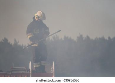 KARWIE?SKIE B?OTA, POLAND, Baltic Sea- AUGUST 2015: Firefighters extinguishing the campfire, Poland, Karwie?skie B?ota on August 15, 2015