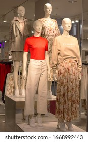 POLAND, BYDGOSZCZ - March 1, 2020: Four bald female mannequins show spring clothes collection. Standing dummies in store. Orange T-shirt, white pants, dress, skirt, sweatshirt, blazer, sneakers