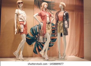 Poland, Bydgoszcz - May 15, 2019: Female mannequins demonstrate a stylish summer autumn spring collection of clothes. Beautiful dolls in the shop window. Fashion & Style storefront
