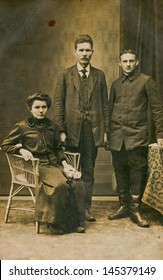 POLAND, CIRCA 1900 - vintage photo of two men and a woman in studio, Poland, circa 1900
