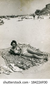POLAND, CIRCA 1940's: Vintage portrait of woman on beach