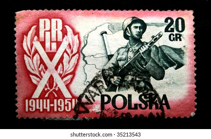 POLAND - CIRCA 1954: A stamp printed in Poland is devoted to 10 years of People Republic Poland, it shows an armed officer, one stamp from a series circa 1954.
