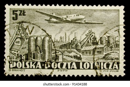 POLAND - CIRCA 1958: A stamp printed in Poland shows airplane abowe industrial enterprise, circa 1958