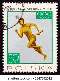 """POLAND - CIRCA 1965: A stamp printed in Poland from the """"Polish Medals in the Olympic Games, Tokyo, Japan 1964"""" issue shows 4x100m relay men, silver medal, circa 1965."""