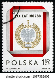 POLAND - CIRCA 1974: a stamp printed in Poland shows Civic Militia and Security Service Badge, 30th Anniversary, circa 1974