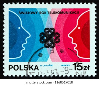 "POLAND - CIRCA 1983: A stamp printed in Poland from the ""World Communications Year"" issue shows Profiles and W.C.Y. Emblem, circa 1983."