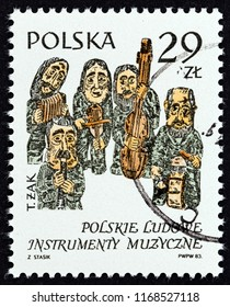 "POLAND - CIRCA 1984: A stamp printed in Poland from the ""Old Musical Instruments"" issue shows Figurines by Tadeusz Zak, circa 1984."