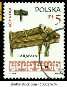 POLAND - CIRCA 1985: A Stamp printed by Poland shows  Wooden  Rattle , series people instruments, circa 1985