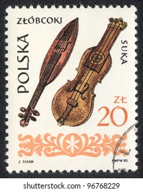 POLAND - CIRCA 1985: A stamp printed in POLAND shows  musical Instruments  Zlobcoki and Suka, from series, circa 1985