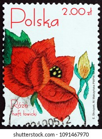 POLAND - CIRCA 2005: a stamp printed in Poland shows Embroided Rose from Lowicz Region, circa 2005