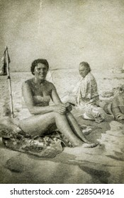 POLAND, CIRCA FORTIES: Vintage photo of two woman on beach