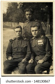 POLAND - CIRCA MAY 16, 1950: Vintage photo shows three Soviet Army sergants, Poland, May 16, 1950