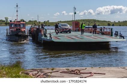 ŚWIBNO, POLAND - CIRCA MAY 2020: Ferry crossing in Świbno on the Baltic Sea circa May 2020 in Świbno.