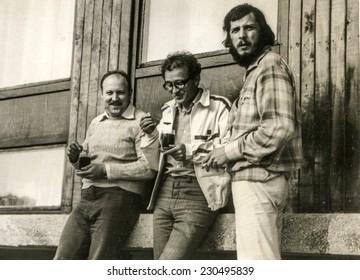 POLAND, CIRCA SEVENTIES: Vintage photo of three young men outdoor