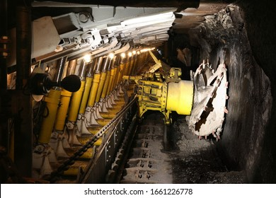 Poland coal mine underground tunnel. Industry in Zabrze, Upper Silesia. Longwall mining shearer machine.