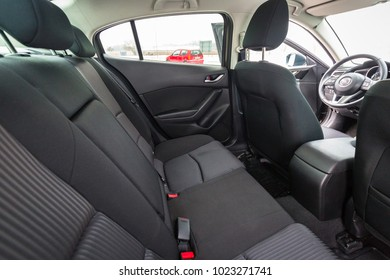 POLAND - FEBRUARY 11, 2018: Black interior of Mazda 3 captured in winter time. Mazda 3 is a popular compact car manufactured in Japan by the Mazda Motor Corporation.