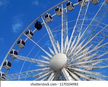 Gdańsk, Poland: Ferris wheel in Gdańsk on a background of blue sky.